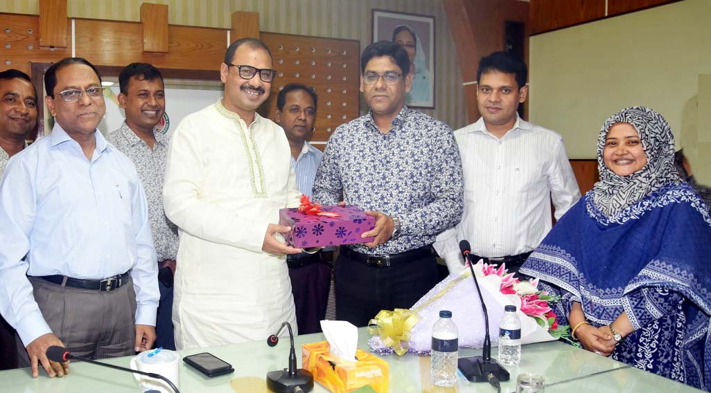 CCC Mayor A J M Nasir Uddin greeting outgoing Chief  Revenue Officer  of CCC Dr Md Mustafizur Rahman at a reception on Wednesday.