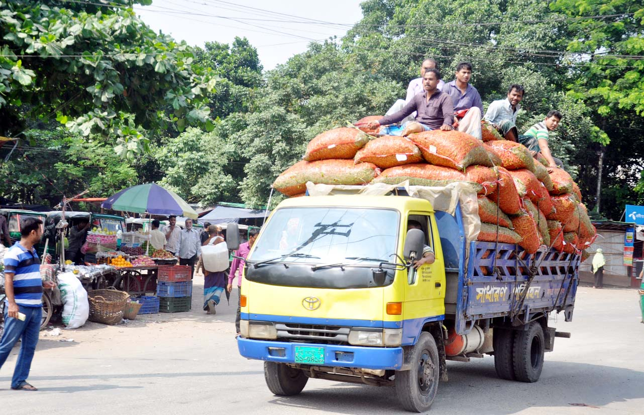 Passengers riding  on roof  of a truck at Tigerpass area in Chattogram City. This picture was taken yesterday.