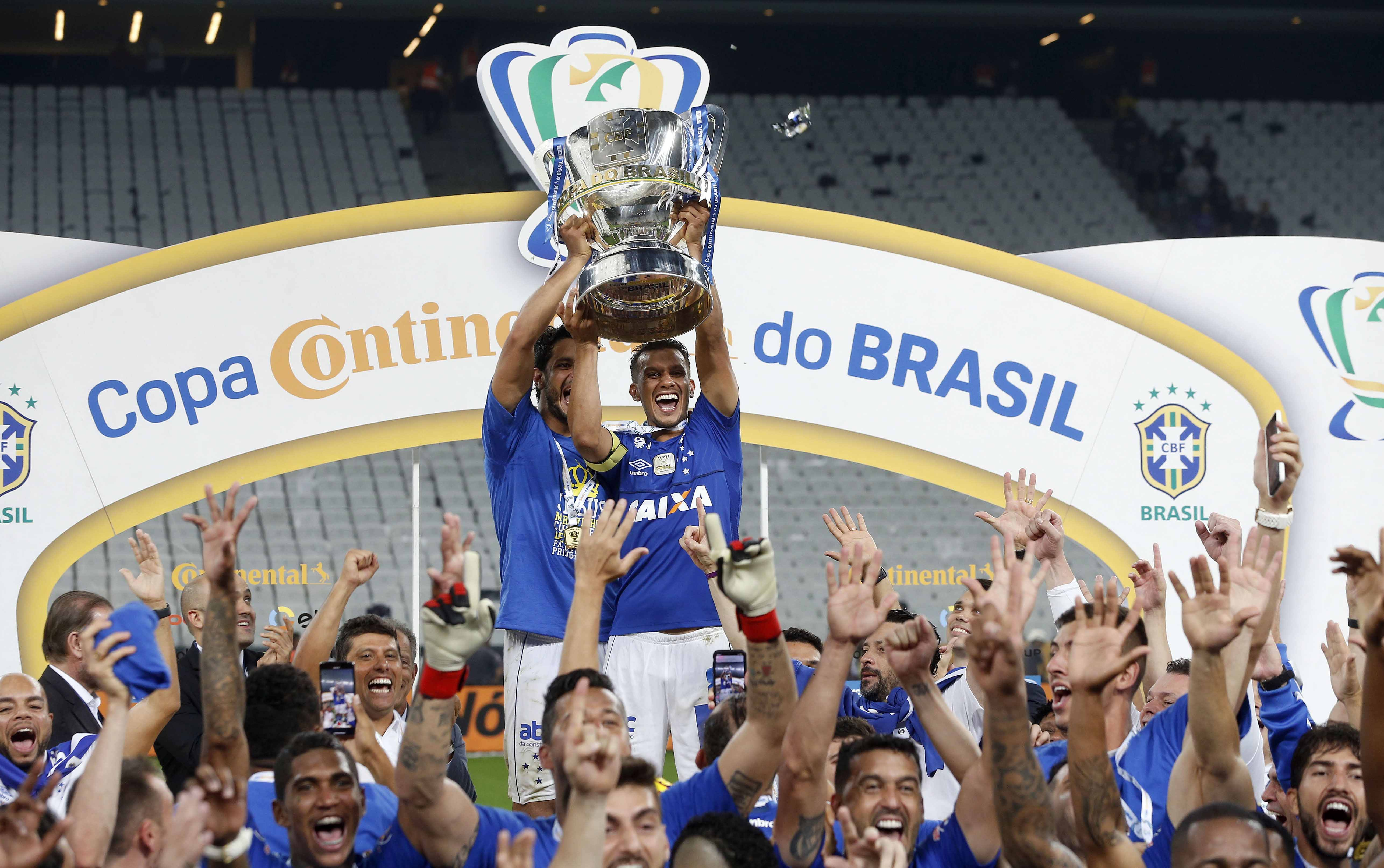 Cruzeiro players lift the Brazil Cup as they celebrate their victory over Corinthians in Sao Paulo, Brazil on Wednesday.