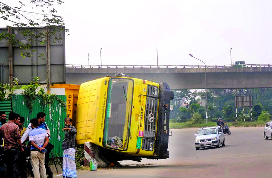 A goods laden covered van overturned on the street underneath the Kuril Flyover as driver lost control of the vehicle on Friday.