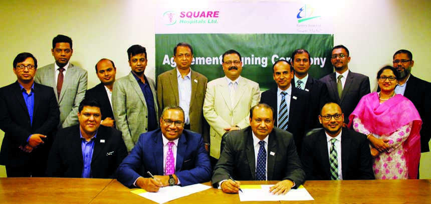 M Khorshed Anowar, Head of Retail Banking, Eastern Bank Limited (EBL) and Md. Esam Ebne Yousuf Siddique, Chief Administrative Officer of Square Hospitals Limited, exchanging an agreement signing document at the Bank's head office in the city recently. Under the deal, cardholders and employees of the Bank will get healthcare service privileges at the Executive Health and Well Being Center of the hospital. Senior officials from both the organizations were also present.