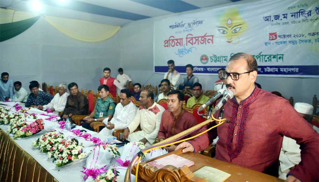 CCC Mayor A J M Nasir Uddin speaking at the immersion programme of Goddess Durga at Patenga Sea Beach as Chief Guest on Friday.