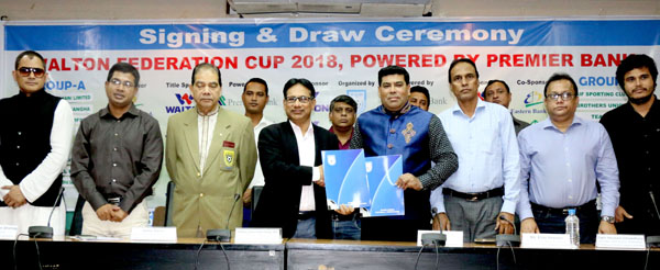 Senior Vice-President of Bangladesh Football Federation (BFF) Abdus Salam Murshedy shaking hands with FM Iqbal Bin Anwar Dawn, Senior Operative Director (Head of Games & Sports) of Walton Group after signing an agreement between BFF and Walton Group at the conference room in BFF House on Saturday.