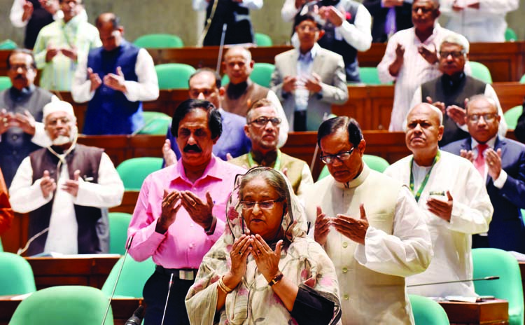Prime Minister Sheikh Hasina offering munajat at the 23rd session of the  Jatiya Sangsad after obituary motions yesterday .