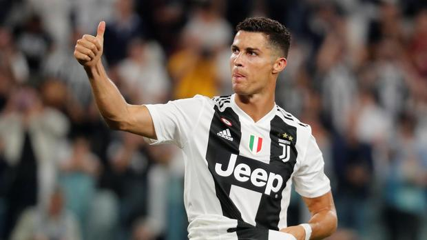 Ronaldo celebrates landmark goal but Juve's perfect run broken