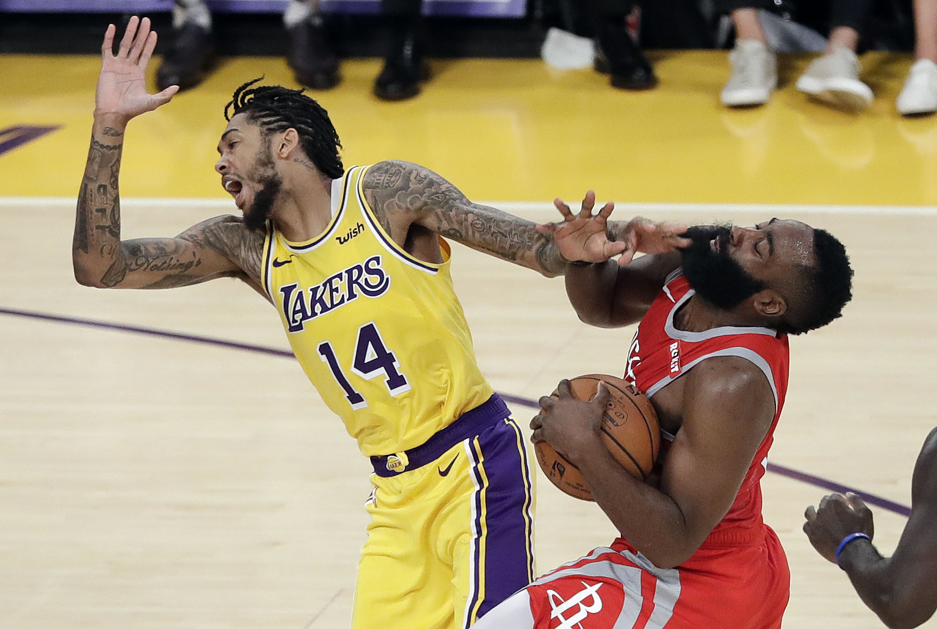Houston Rockets' James Harden (right) collides with Los Angeles Lakers' Brandon Ingram (14) during the second half of an NBA basketball game in Los Angeles on Saturday.
