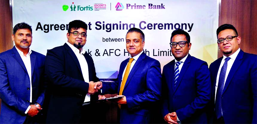 ANM Mahfuz, Head of Consumer Banking of Prime Bank Limited and Nazeem A. Choudhury, Chief Executive of AFC Health Limited, exchanging an agreement signing documents at the Bank's head office in the city recently. Under the deal, Monarch (Priority Banking) customers, credit/debit card holders and employees of the Bank will enjoy preferential pricing at the hospital. Senior officials from both the organigations were also present.