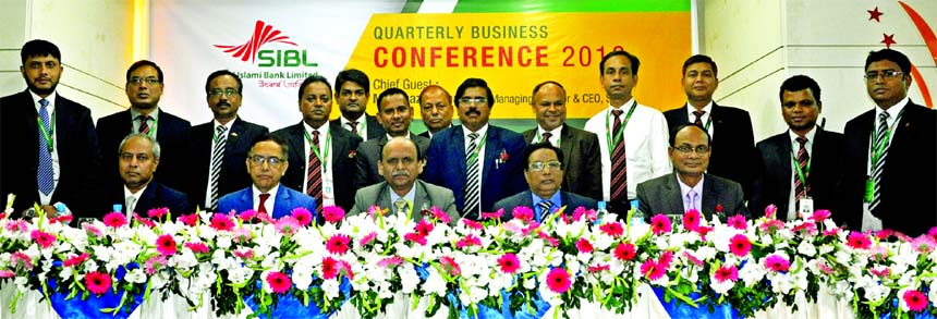 Quazi Osman Ali, Managing Director of Social Islami Bank Limited (SIBL), poses for a photograph with the participants of a daylong Business Conference-2018 to evaluate the business position of the Bank at a hotel in the city on Saturday. Ihsanul Aziz, Kazi Towhidul Alam, AMDs, Abu Naser Chowdhury, and Md. Sirajul Hoque, DMDs of the Bank were also present.