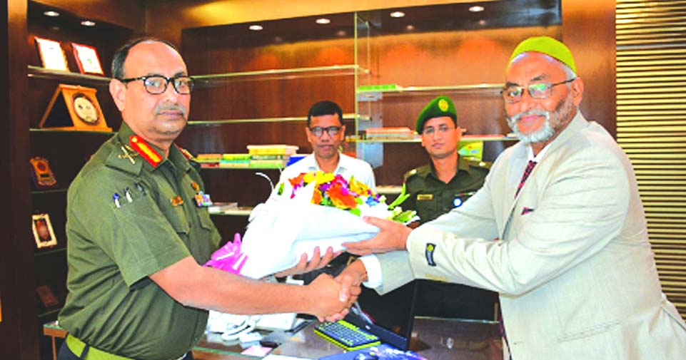 Mohammad Jalaluddin, Managing Director of Ansar-VDP Unnayan Bank, congratulating its newly appointed Chairman Major General Kazi Sharif Kaikobad with bouquet at the Bank's head office in the city recently.