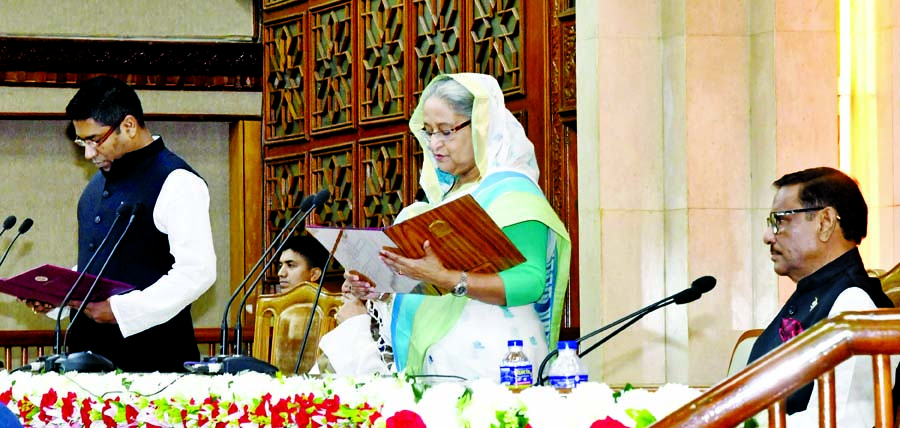 Prime Minister Sheikh Hasina administering oath to the newly elected Mayor of Barishal City Corporation Serniabat Sadik Abdullah at her office in the city on Monday.
