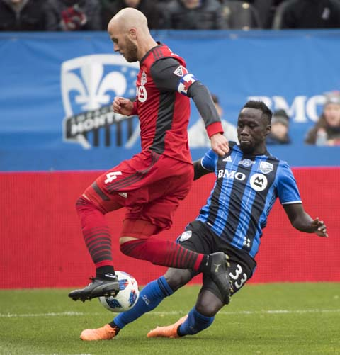 Toronto FC's Michael Bradley (left) challenges Montreal Impacts Bacary Sagna during first half MLS soccer action in Montreal on Sunday.
