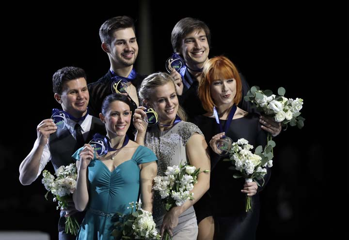 Medal winners in the ice dance program pose for a photo during a ceremony at Skate America on Sunday in Everett, Wash. From left: Charlene Guignard and Marco Fabbri, of Italy, who won silver, Madison Hubbell and Zachary Donohue, of the US, who won gold, and Tiffani Zagorski and Jonathan Guerreiro, of Russia, who won bronze.