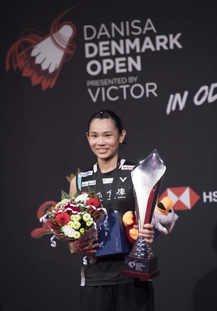 Tai Tzu Ying of Chinese Taipei, holds the trophy after winning the final match against Saina Nehwal of India, during the Women's Singles Final match at the Denmark Open badminton championship, in Odense,    Denmark on Sunday.
