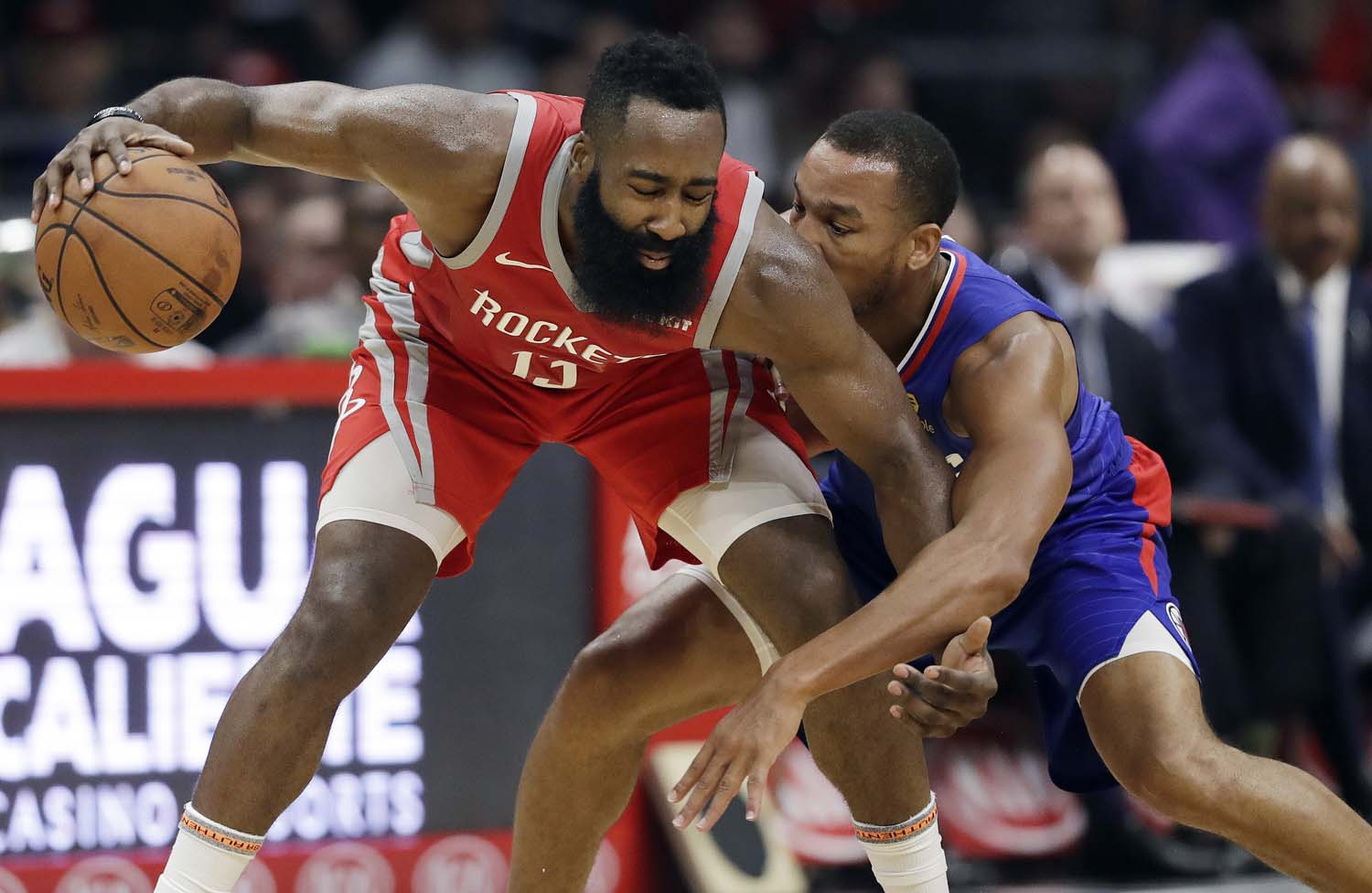 Houston Rockets' James Harden (13) is defended by Los Angeles Clippers' Avery Bradley during the first half of an NBA basketball game on Sunday.