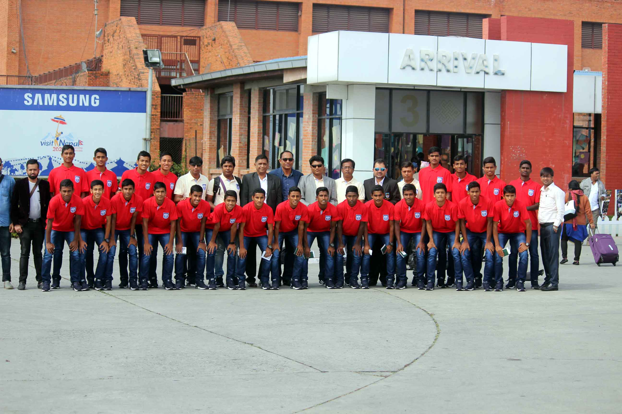 Bangladesh Under-15 National Football team with the officials pose for a photo session in Nepal on Tuesday.