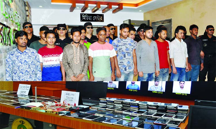 RAB mobile team in a drive in city's Gulshan area arrested 15 active members of criminal gangs with huge mobile phones and IMEI number changing materials. This photo was taken from RAB media centre on Tuesday.
