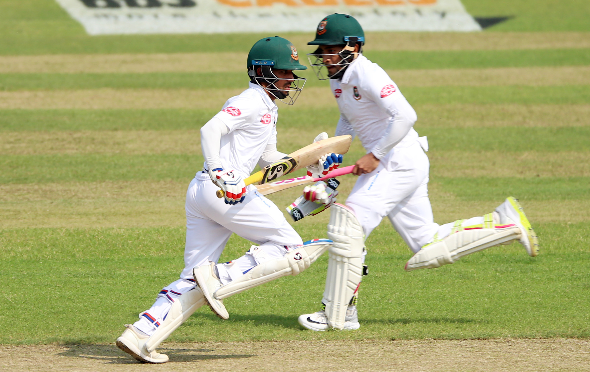 Mominul Haque (left) and Mushfiqur Rahim running between wicket during the first day play of the second Test between Bangladesh and Zimbabwe at the Sher-e-Bangla National Cricket Stadium in the city's Mirpur on Sunday. Both batsmen hit century each on the day.