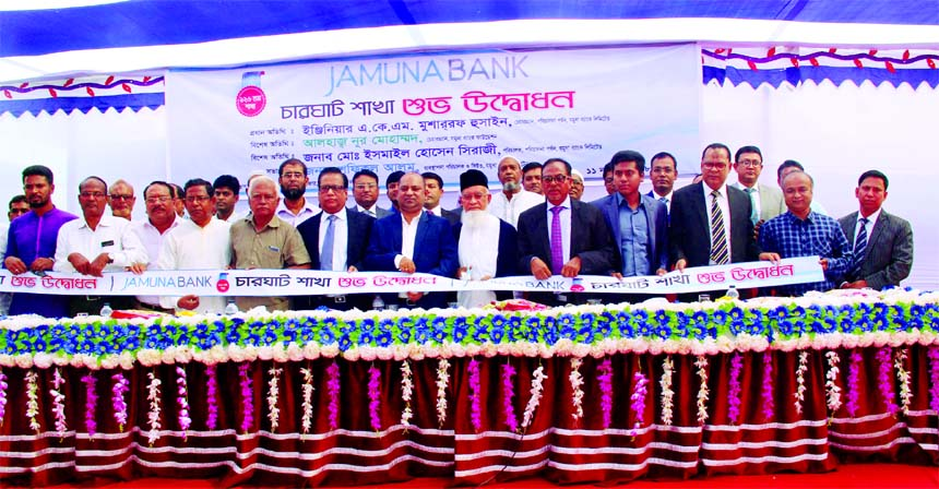 Eng. AKM Mosharraf Hussain, Chairman of Jamuna Bank Limited, inaugurating its 126th Branch at Charghat in Bagha in Rajshahi recently. Shafiqul Alam, Managing Director, Nur Mohammed, Chairman of Jamuna Bank Foundation, Md. Ismail Hossain Siraji, Director, zonal heads of the Bank and local elites were also present.