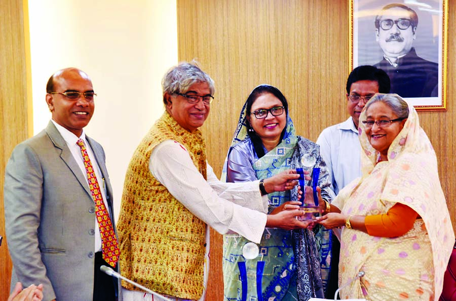 Prime Minister Sheikh Hasina receiving ASOCIO 2018 Digital Government  Award from Post, Telecommunication and Information Technology Minister Mostofa Zabbar at the cabinet meeting on Monday.