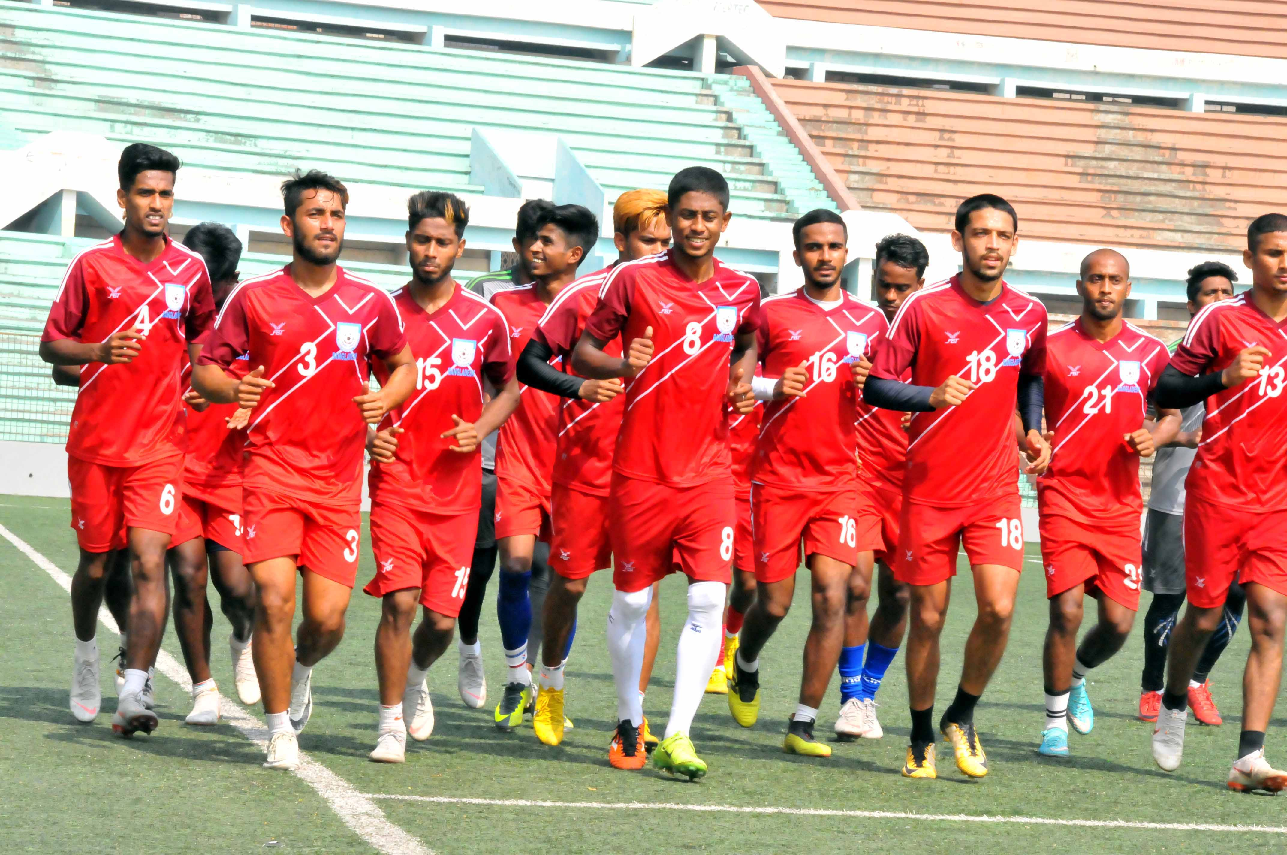 Players of Bangladesh Under-23 Football team during their practice session at the Bir Shreshtha Shaheed Sepoy Mohammad Mostafa Kamal Stadium in the city's Kamalapur on Monday.