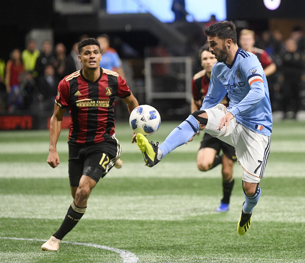 New York City forward David Villa (7) movers the ball as Atlanta United defender Miles Robinson (12) defends during the first half of their MLS playoff soccer match in Atlanta on Sunday.