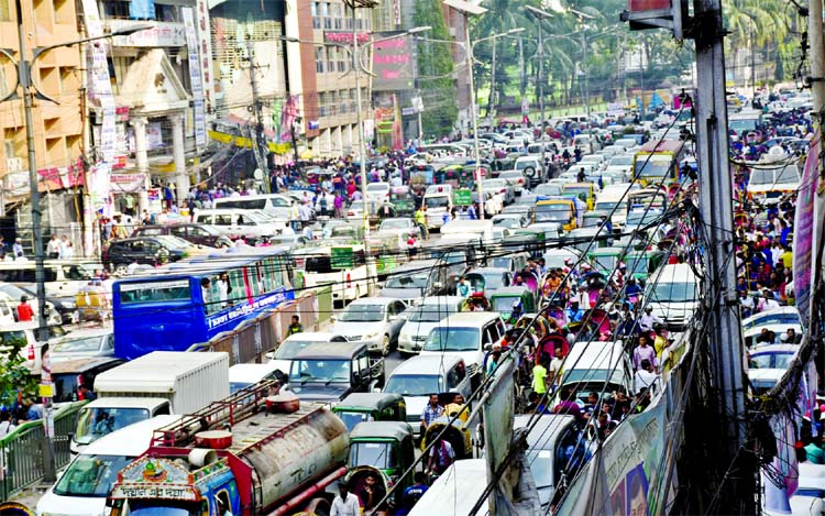 City people experienced huge traffic gridlock due to selling of nomination forms by various political parties for participating in next National Election. This picture was taken from Naya Paltan area on Monday.