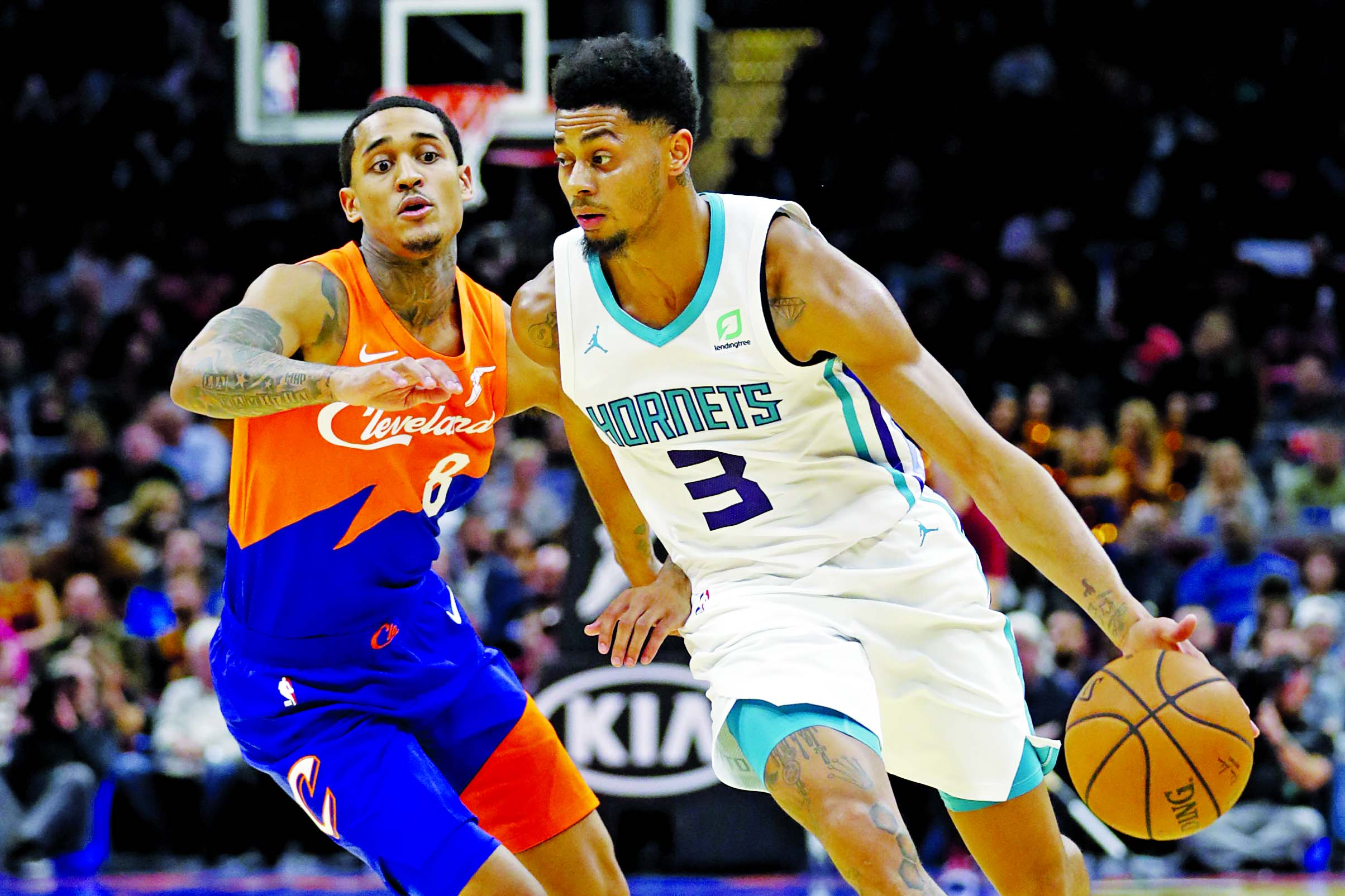 Charlotte Hornets' Jeremy Lamb (3) drives against Cleveland Cavaliers' Jordan Clarkson (8) in the second half of an NBA basketball game in Cleveland on Tuesday. The Cavaliers won 113-89.