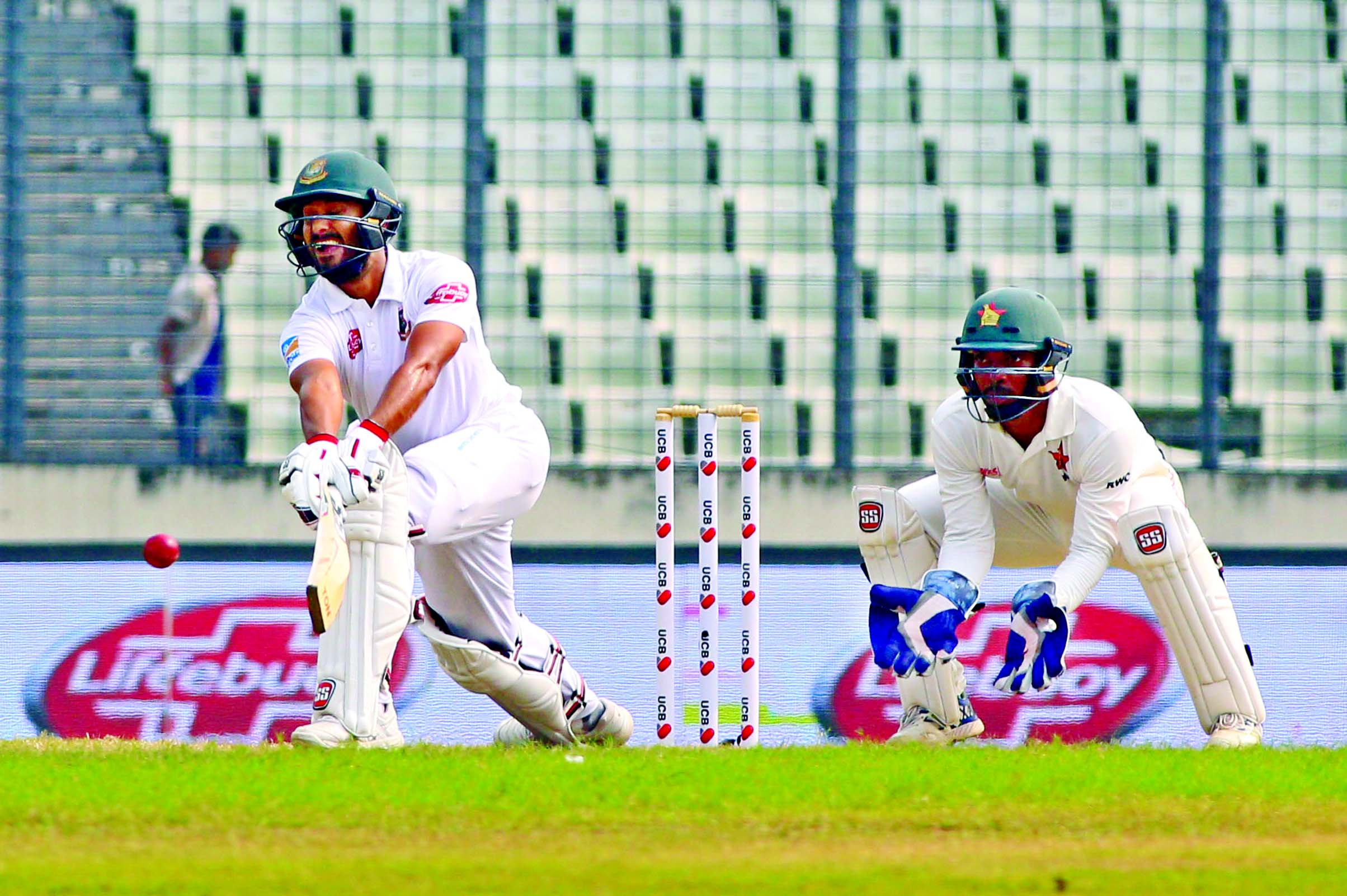 Mohammad Mithun (left) of Bangladesh plays a shot while wicketkeeper Regis Chakabva of Zimbabwe looks on during the fourth day play of the second Test between Bangladesh and Zimbabwe at the Sher-e-Bangla National Cricket Stadium in the city's Mirpur on Wednesday.