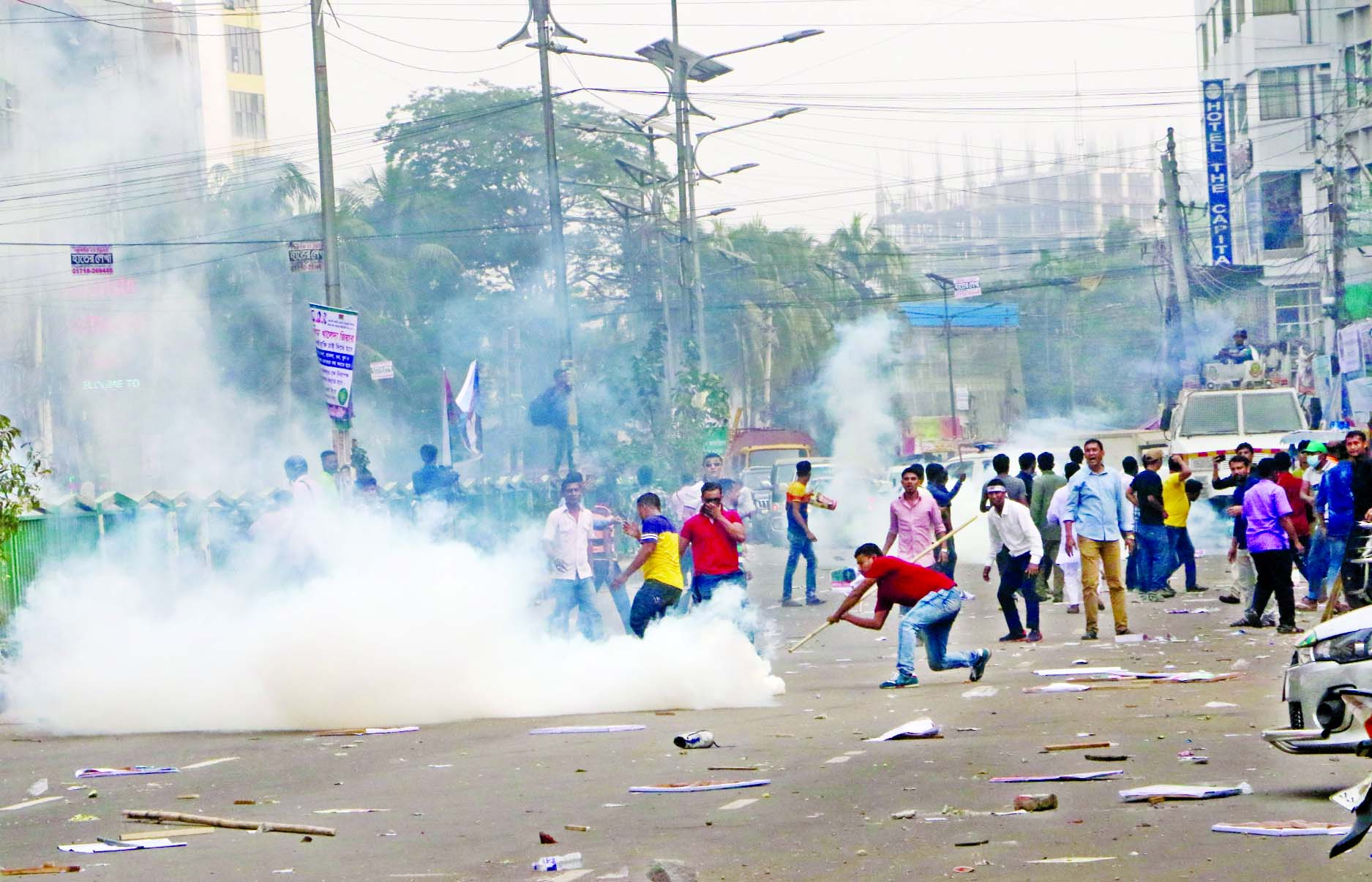 Police lob teargas shells to disperse the crowd while they staged a big showdown in front of Nayapaltan's BNP office during nomination seeking time ahead of national election for 3rd consecutive day on Wednesday.