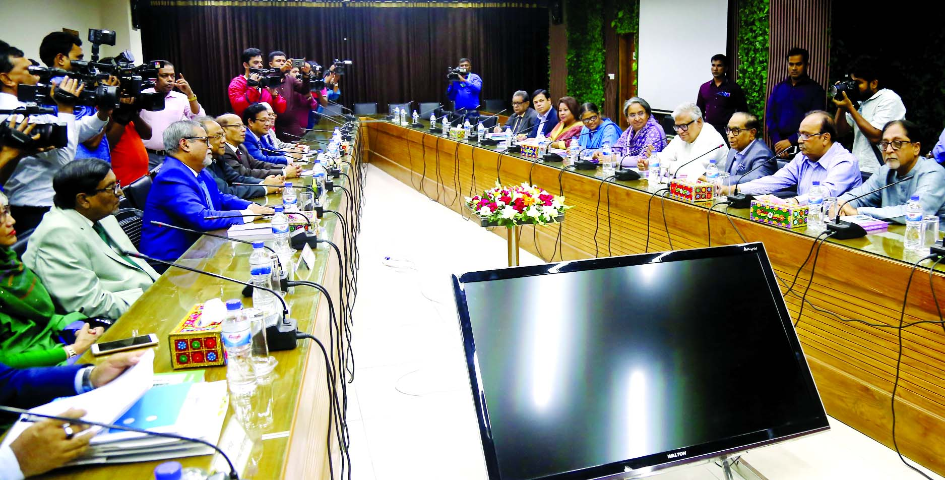 Awami League delegation headed by Prime Minister's Political Adviser HT Imam holding talks with CEC KM Nurul Huda on various election-related issues at Nirbachon Bhaban on Wednesday.