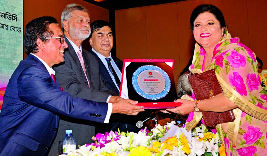 Nargis Sultana receiving tax card and crest as a highest tax payer in personal category in the City Corporation area from State Minister for Finance and Planning at a function organized by National Board of Revenue (NBR) at Sonargaon Hotel in the city recently.