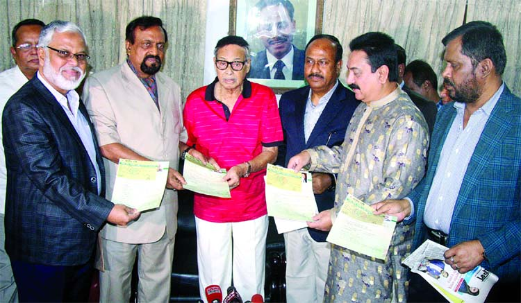 Secretary General of Jatiya Party ABM Ruhul Amin Hawlader along with other presidium members of the party submitting nomination forms for the eleventh parliamentary elections to the party Chairman Hussain Muhammad Ershad at its Banani office in the city on Thursday.
