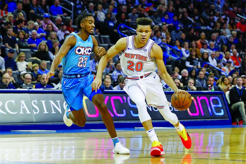 New York Knicks forward Kevin Knox (20) drives to the basket around Oklahoma City Thunder guard Terrance Ferguson (23) during the first half of an NBA basketball game in Oklahoma City, Wednesday.