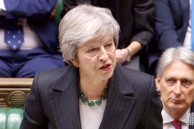 May fights for survival after Brexit deal sparks crisis