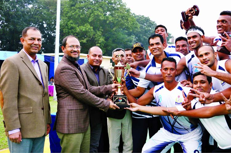 Assistant Chief of Naval Staff (Material) Rear Admiral M Shafiul Azam giving away trophy to Bangladesh Navy team, who clinched Inter-Service Basketball title at BAF Base Bangabandhu in the city\'s Kurmitola on Thursday.