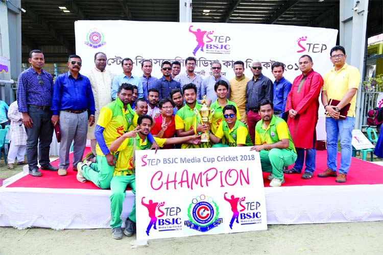 . Members of Bangla Tribune, the champions of the Step-BSJC Media Cup Cricket Tournament with the guests and officials of Bangladesh Sports Journalists Community (BSJC) pose for photograph at the Outer Stadium, which is adjacent to the Bangabandhu National Stadium on Friday.