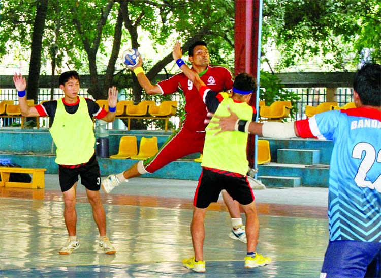 A moment of the match of the EXIM Bank 28th National Men\'s Handball Championship between BGB and Bandarban District team at the Shaheed (Captain) M Mansur Ali National Handball Stadium on Friday.