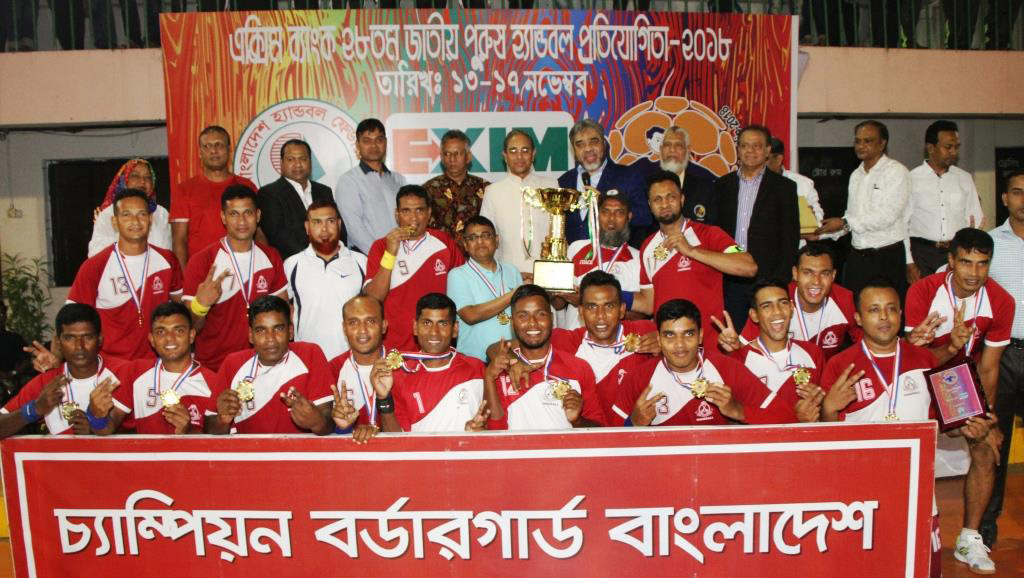 Members of BGB, the champions of the EXIM Bank 28th National Handball Competition with the guests and officials of Bangladesh Handball Federation pose for a photo session at the Shaheed (Captain) M Mansur Ali National Handball Stadium on Saturday. BGB defeated Bangladesh Police by 25-17 goals in the final. Bangladesh Police finished runners-up in the meet.