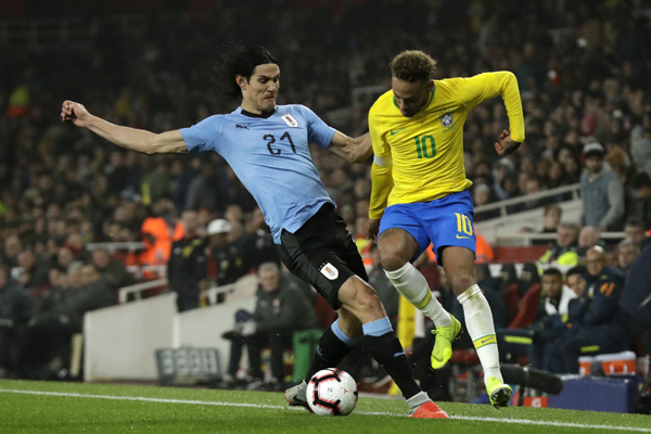 Neymar penalty punishes Uruguay in feisty friendly