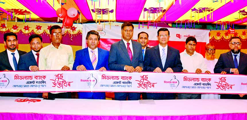 Md. Ahsan-uz Zaman, Managing Director of Midland Bank Limited, inaugurating its agent banking centre at Sonahata Bazar under Dhunot Thana of Bogura on Saturday.  Md. Ridwanul Haque, Head of Retail Distributions and Agent Banking Division of the Bank was also present.