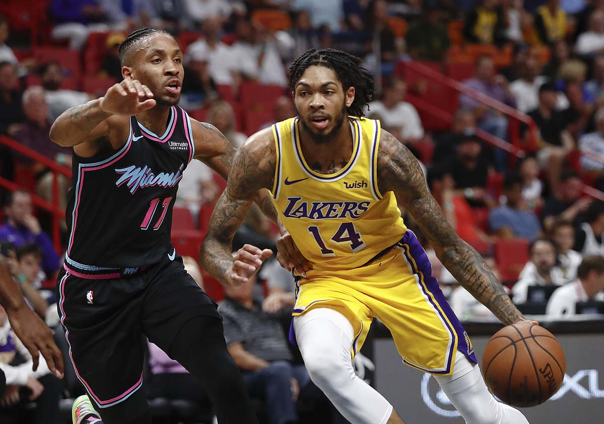Los Angeles Lakers forward Brandon Ingram drives as Miami Heat forward Rodney McGruder defends during the first half of an NBA basketball game on Sunday.