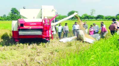 MOULVIBAZAR: Farmers at  Moulvibazar passing busy time  for  paddy harvest  by using Combined Harvester assisted by Agriculture Department as the district has achieved bumper Aman paddy production this season. This picture was taken on Sunday.