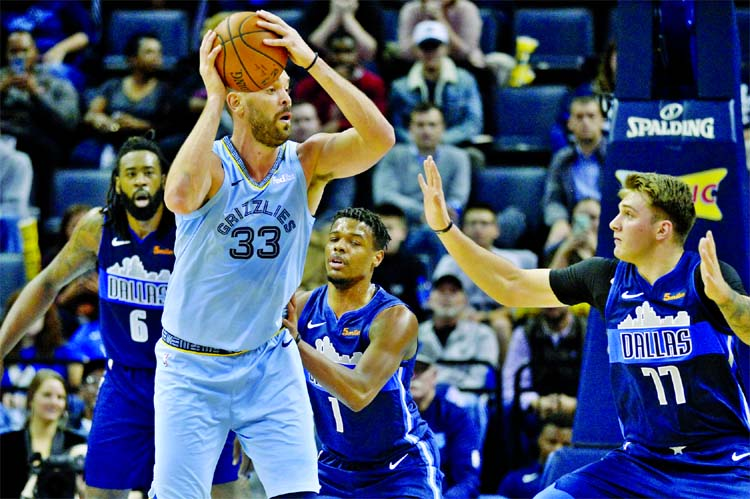 Memphis Grizzlies centerM arc Gasol (33) controls the ball against Dallas Mavericks guard Dennis Smith Jr. (1) and forward Luka Doncic (77) in the first half of an NBA basketball game in Memphis, Tenn on Monday.
