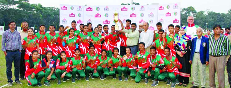 Members of BKSP, the champions of the Teer National Youth (male & female) Archery Championship with the guests and officials of Bangladesh Archery Federation pose for a photo session at Shaheed Ahsan Ullah Master Stadium in Tongi, Gazipur on Tuesday.