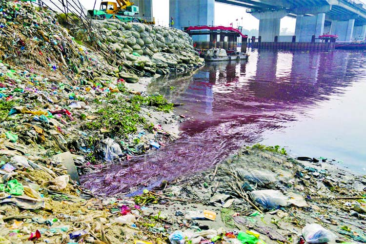 Due to dumping of industrial waste, the water of Shitalakkhya River has been badly contaminated. This picture was taken from Kanchpur area on Tuesday.