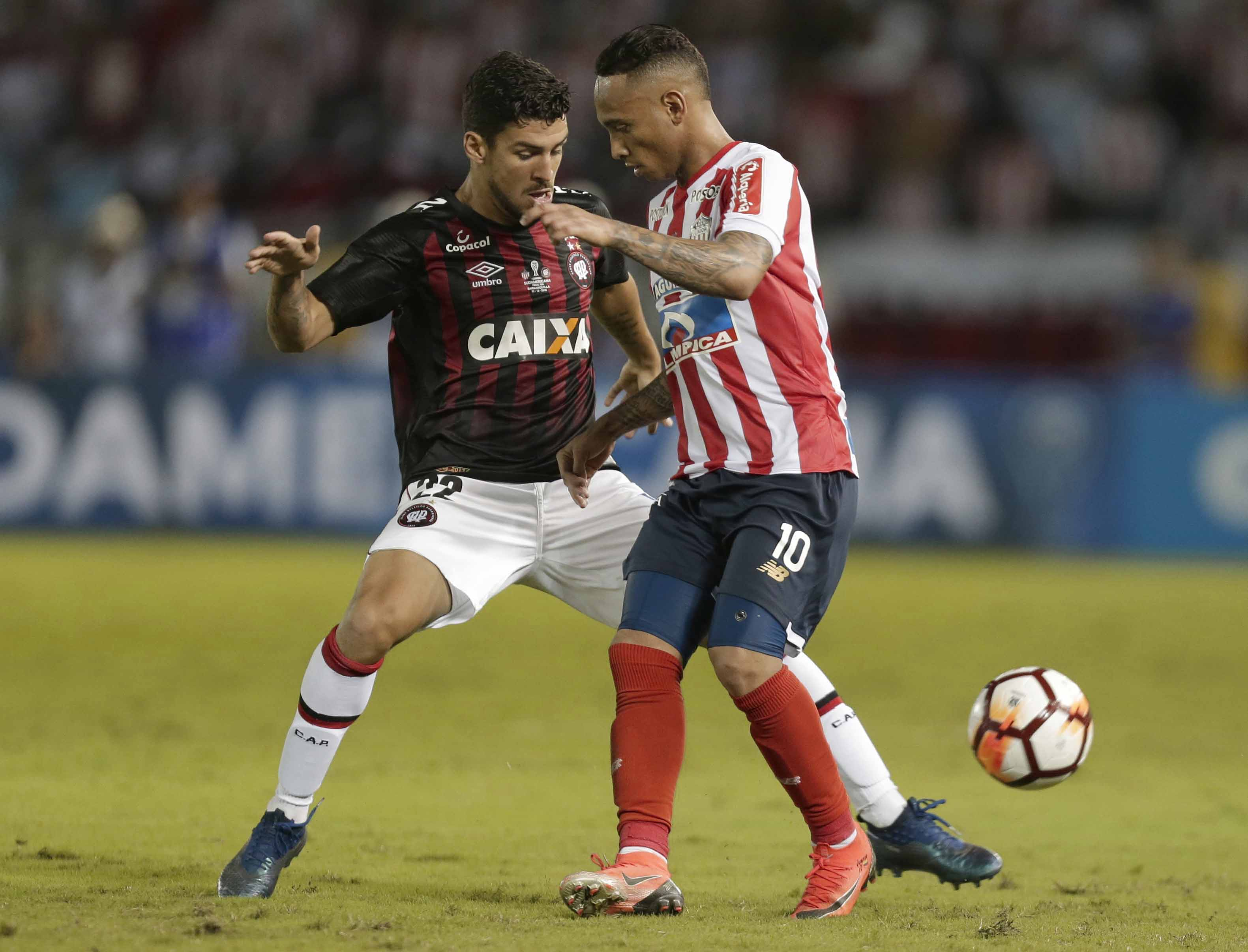 Marcinho of Brazil's Atletico Paranaense (left) fights for the ball with Jarlan Barrera of Colombia's Junior during a Copa Sudamericana first leg final match at the Metropolitano stadium in Barranquilla, Colombia on Wednesday.