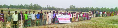 GANGACHARA(Rangpur): People at Motukpur and Chilakhal Char area formed a human chain protesting establishment of solar power plant  on cultivable land  on Wednesday.