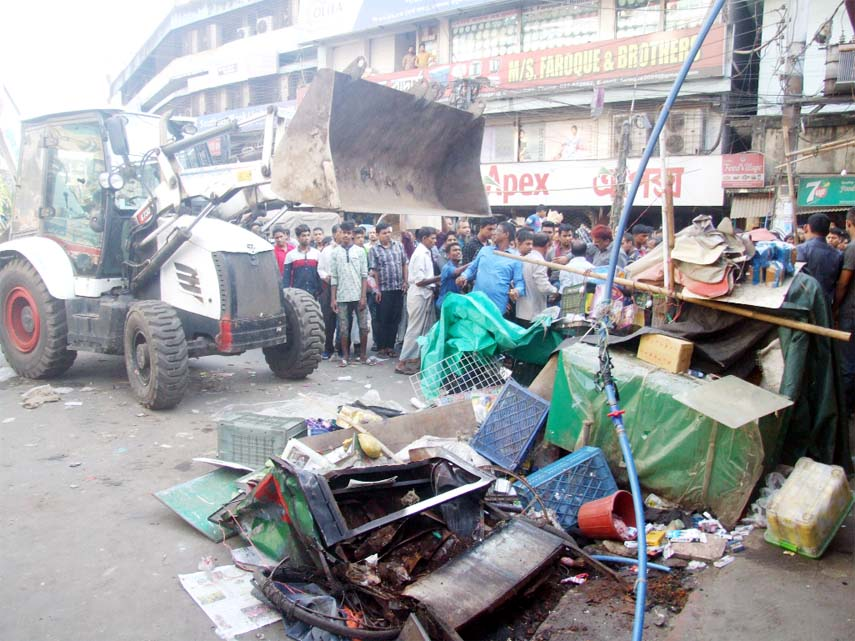 CCC Mobile court  conducting evicting drive against  illegal constructions from Riazuddin Bazar point on Tuesday.
