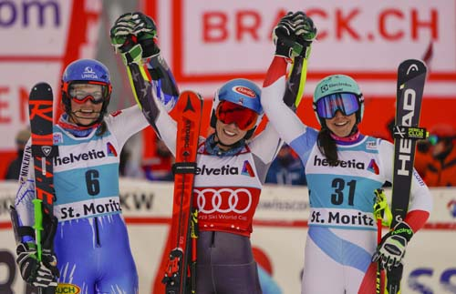 United States' Mikaela Shiffrin (center) winner of a women's World Cup parallel slalom, poses with second placed Slovakia's Petra Vlhova  (left) and third placed Switzerland's Wendy Holdener in St. Moritz, Switzerland on Sunday.