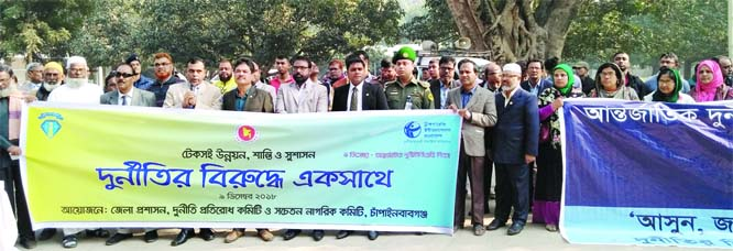 CHAPAINAWABGANJ: A Z M Nurul Haque , DC, Chapainawabganj speaking at a human chain on the occasion of the International Anti Corruption Day as Chief Guest yesterday.